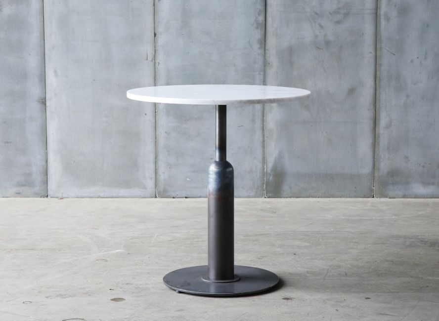 Apollo – a café table in marble, teak or oak by Heerenhuis
