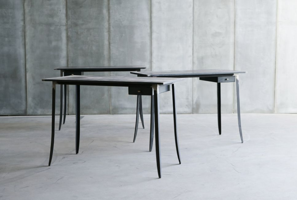 Hide II desk with leather top by Heerenhuis