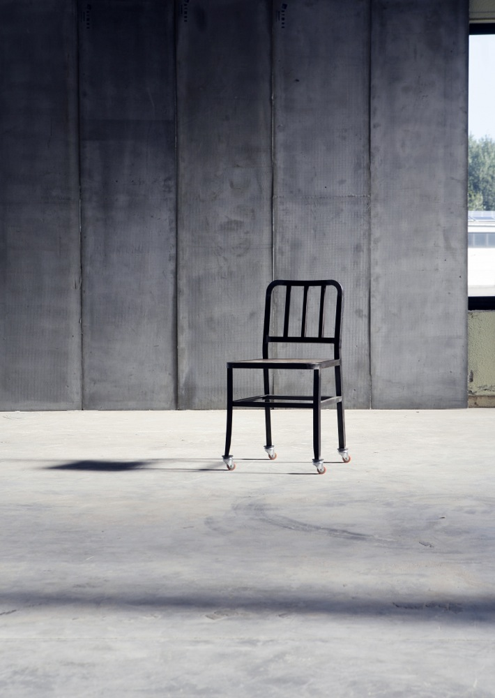 Metal Chair with wheels & leather seat by Heerenhuis