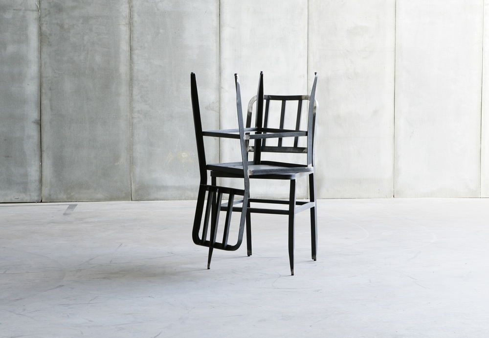 Metal Chair with leather seat by Heerenhuis