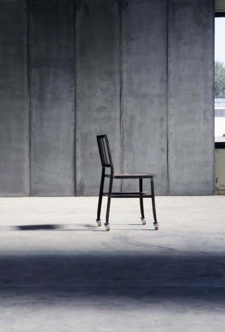 Metal Chair II with wheels & leather seat by Heerenhuis