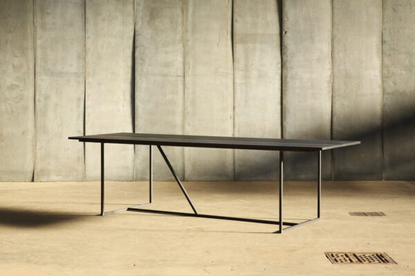 Mesa Nero II - a table in distressed French oak by Heerenhuis