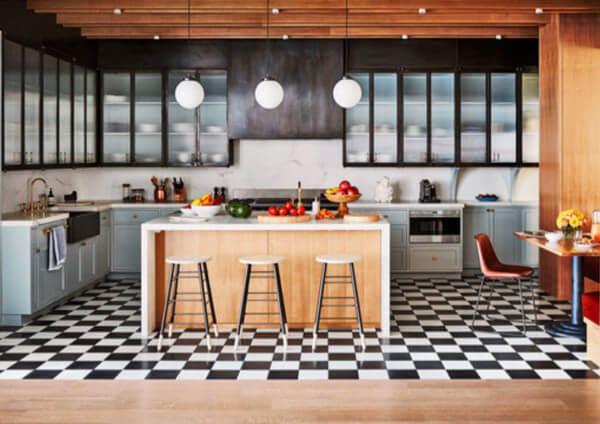 Iron dining chairs by Sol y Luna – Naomi Watts in Architectural Digest 2