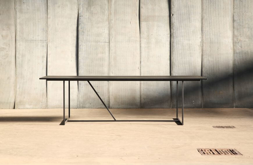 Mesa Nero – a table in distressed French oak by Heerenhuis at Different Like a Zoo