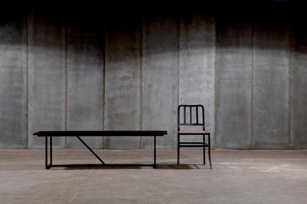 Mesa Nero - a black bench in solid oak and Metal Chair by Heerenhuis