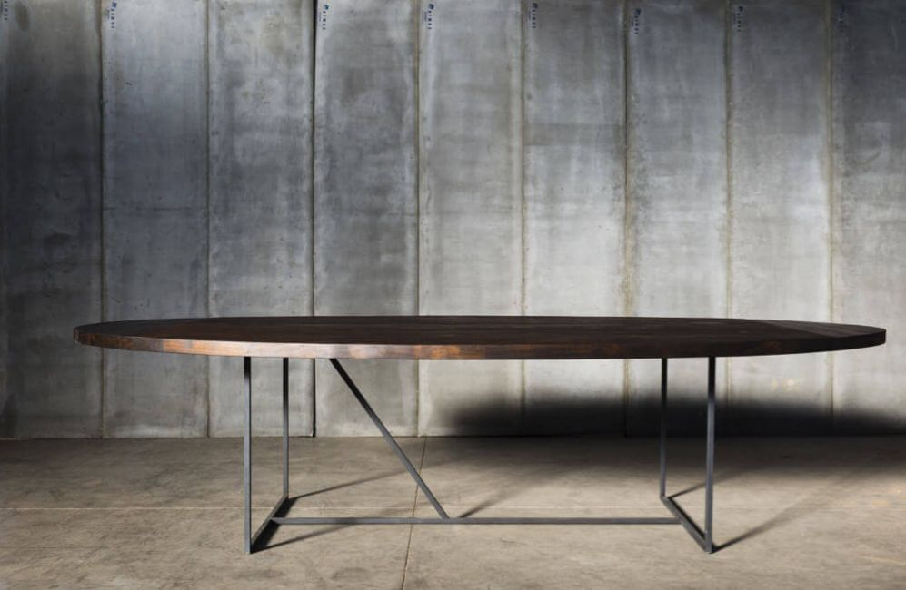 Mesa OV table with reclaimed teak top and charcoal finish over a solid metal base by Heerenhuis