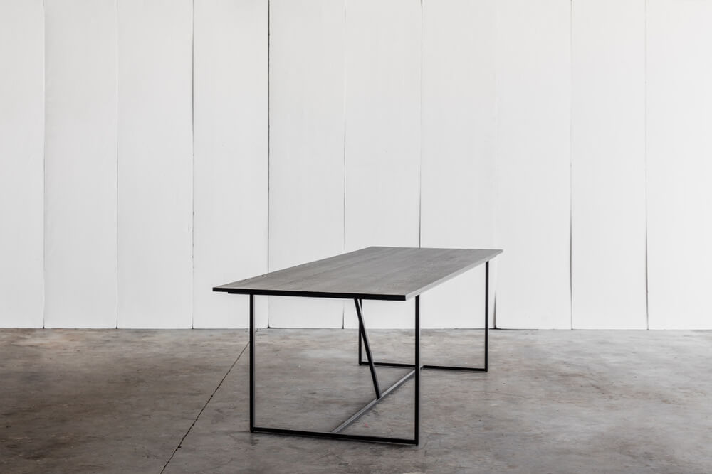 Mesa Nero - a table in solid blackened oak by Heerenhuis