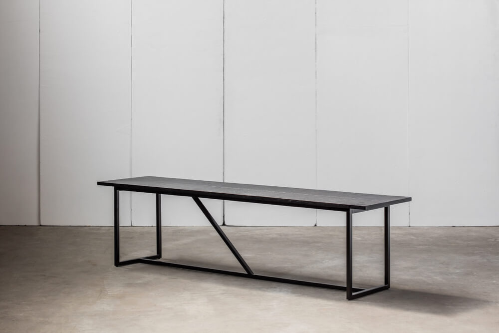 Mesa Nero - a bench in solid blackened oak by Heerenhuis
