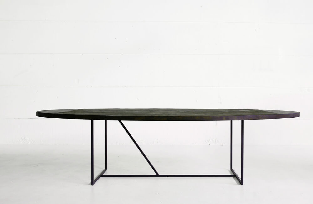 Mesa OV table - reclaimed teak top with charcoal finish over a solid metal base by Heerenhuis