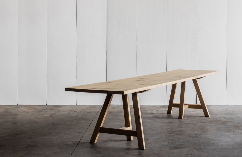 Trestle table in solid French oak by Heerenhuis