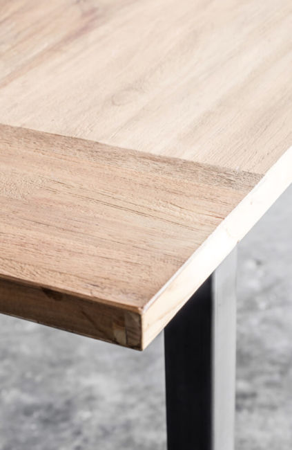Tube – a table in reclaimed laminated teak by Heerenhuis