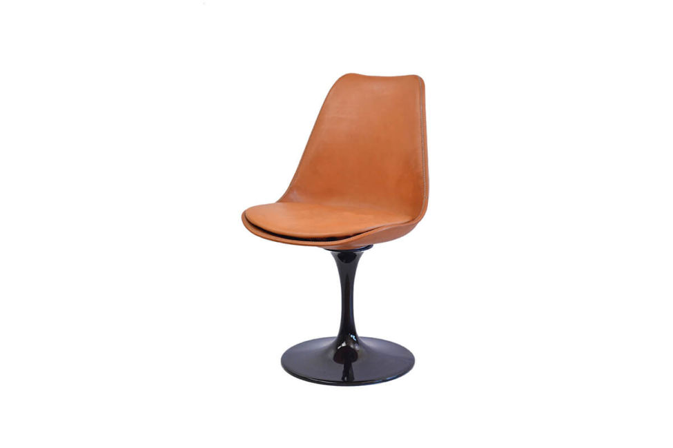 Revolving dining chair in natural leather with black swivel base by Sol & Luna