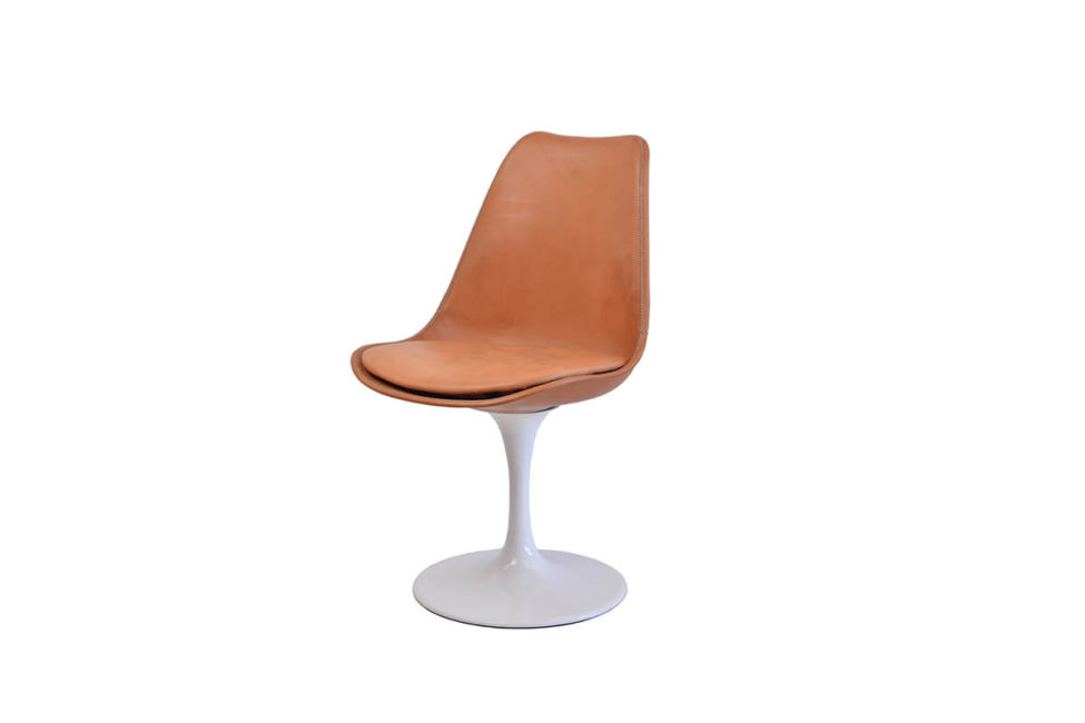 Revolving dining chair in natural leather with white swivel base by Sol & Luna